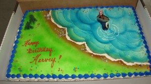 Fisherman cake complete with authentic plastic fisherman with beard drawn on.